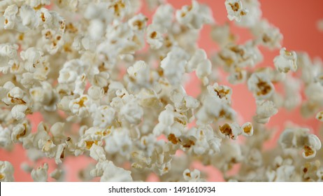 Flying popcorn, isolated on pink background