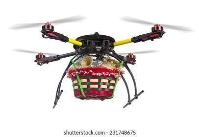 A flying quadrocopter with a basket of Christmas goodies attached to its belly isolated on white. Clipping path is included.