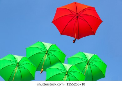 Flying red and green umbrellas