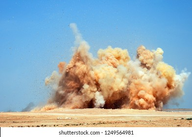 The flying rock particles and dust clouds after the blast