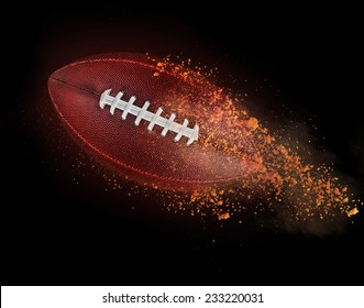 flying rugby ball with dirt isolated on black.