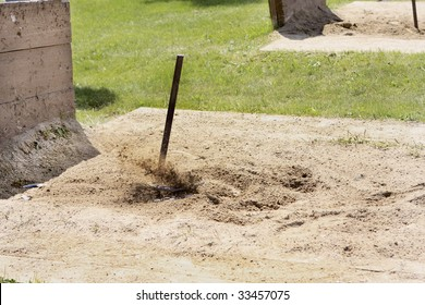 Flying sand as the Horseshoe ringer is made.