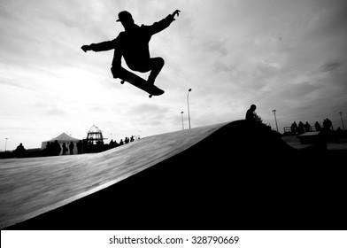 Flying skateboard rider in the park