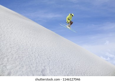 Flying skier on mountains. Extreme winter sport.