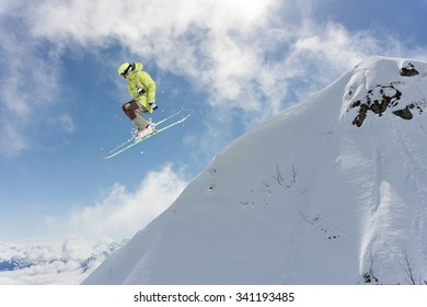 Flying skier on mountains. Extreme winter sport