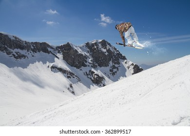Flying skier on mountains. Extreme sport.