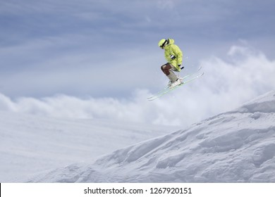 Flying skier on snowy mountains. Extreme winter sport, alpine ski.