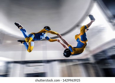 I flying. Skydiving in Russia wind tunnel. Indoor skydiving. Training in wind tunnel. New  sport in flight technology. Flying in fast wind
