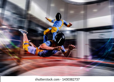 I flying. Skydiving in wind tunnel. New skydiving sport in flight technology. Indoor skydiving. Training in wind tunnel. Surfing on people