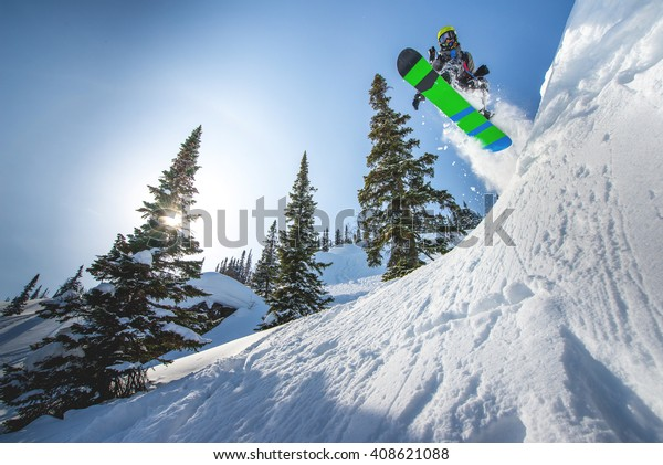 Flying snowboarder in the mountains