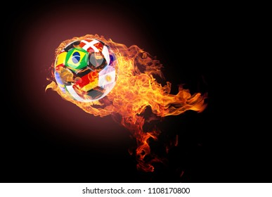 Flying soccer ball on a dark background with flames