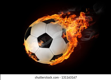 Flying soccer ball on fire -falling down