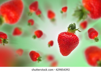 Flying strawberries on green background