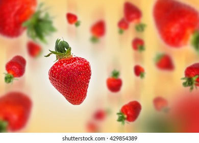 Flying strawberries on orange background