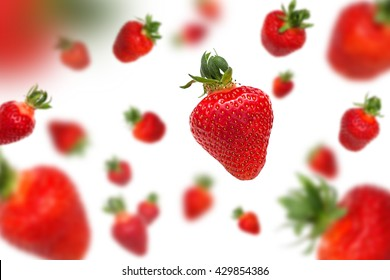 Flying strawberries on white background