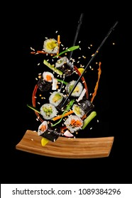 Flying sushi pieces isolated on black background. Concept of food levitation, high resolution image