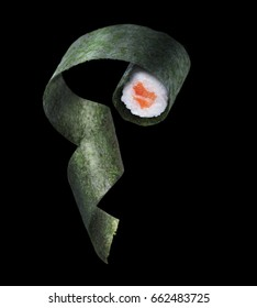Flying sushi with salmon on a black background.