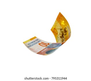 Flying Swiss money - 10 francs note isolated with clipping path