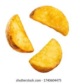 Flying tasty fried potato wedges, isolated on white