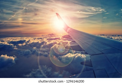 flying and traveling ,view on sunset from airplane window