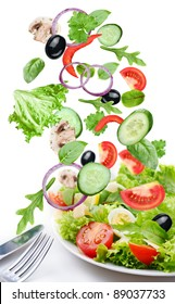 Flying vegetables - salad ingredients. Isolated on a white background.