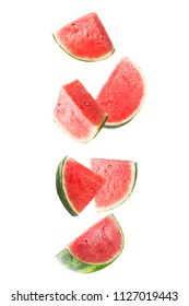 Flying watermelon. Sliced falling watermelon isolated on white background with clipping path as package design element and advertising. Floating fruits in the air.