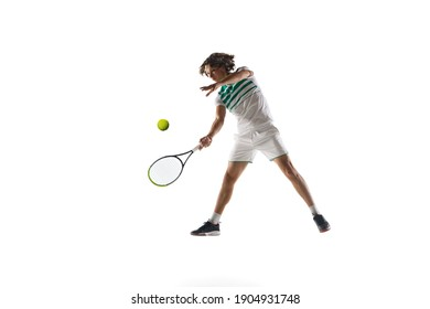 Flying. Young caucasian professional sportsman playing tennis isolated on white background. Training, practicing in motion, action. Power and energy. Movement, ad, sport, healthy lifestyle concept.