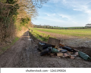 Flytipped waste in Rural byway in Kent, England