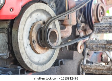 Flywheel and belt of walking tractor engine.