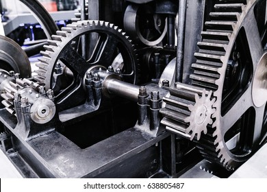 Flywheel gear in industrial machine closeup