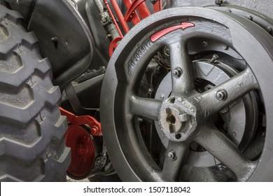 Flywheel of a historic tractor.