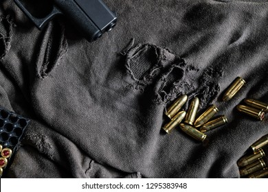 FMJ 9mm automatic pistol ballistic on cloth background, Violence concept