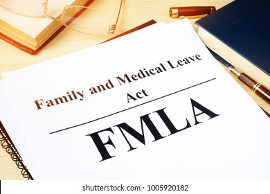 FMLA Family and Medical Leave Act on a desk.