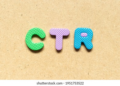 Foam alphabet letter in word CTR (Abbreviation of Click trough rate) on wood background