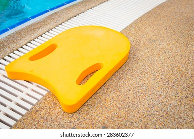 Foam board for the teaching of swimming beside swimming pool