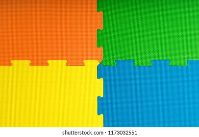 Foam flooring tiles / mats inside a play room, kindergarten school or gym. Potential use as a colourful background with copy space.