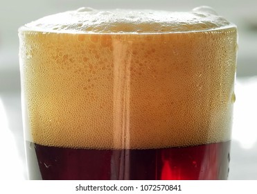 foam in a glass with kvass