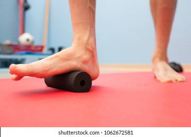 Foam roller plantar fascia treatment in physiotherapy studio.