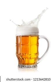Foam splash in the faceted beer mug isolated on white background