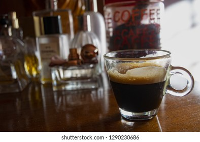 foamy extra strong coffee espresso on a wooden background