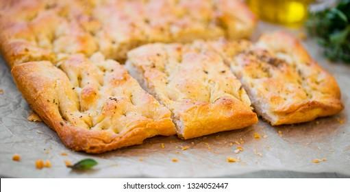 Focaccia bread with oregano and olive oil.Fresh italian foccacia bread closeup with mediterranean ingredients