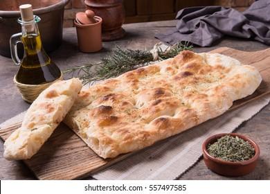 Focaccia romana's bread on rusti still life composition