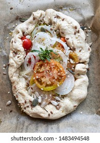 Focaccia with tomato, onion, olive oil and herbs.