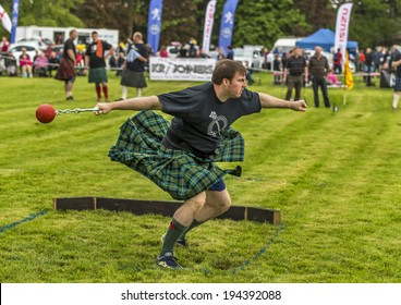 FOCHABERS, MORAY, SCOTLAND - 18 MAY: Participant in the 28lb for distance competition at the Gordon Castle Highland Games, Fochabers, Moray, Scotland on 18 May 2014.