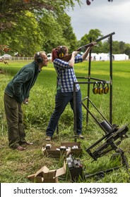 FOCHABERS, MORAY, SCOTLAND - 18 MAY: Clay Pigeon Shooting tuition at the Gordon Castle Highland Games, Fochabers, Moray, Scotland on 18 May 2014.