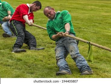 FOCHABERS, MORAY, SCOTLAND - 18 MAY: A Tug of War team at the Gordon Castle Highland Games, Fochabers, Moray, Scotland on 18 May 2014.
