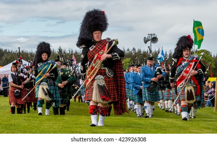 FOCHABERS,MORAY,SCOTLAND - 15 MAY: This is the massed pipe bands marching in the arena of Gordon Castle Highland Games, Fochabers, Moray, Scotland on 15 May 2016.