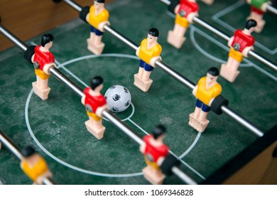 focus ball in start soccer table game. Boy toy sport game concept. Soccer table is relax activities indoor for kid and family.