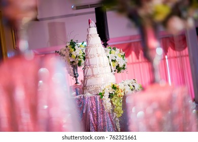 Focus the cake in wedding ceremony. pink color theme wedding party with wonderful cake. symbol of wedding day concept. image for background, wallpaper and copy space.
