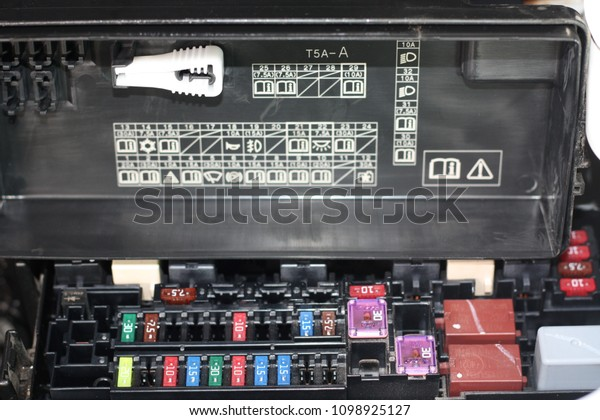 focus of car fuse box in low key light , control engine lighting of car